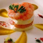 Millefeuilles of  Campania's mozzarella cheese  with raw prawns and broccoli sauce