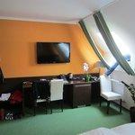 Room with orange walls and green floor