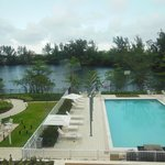 View of pool from room w/ the blinds