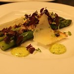 Grilled asparagus with a ramslök emultion, roasted pistachio dressing, shaved manchego cheese