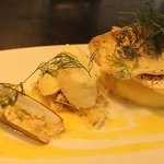 Poached pike perch with a scalop muselin, razor clambs and butter sauce