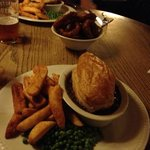 Pie, peas, chips and onion rings