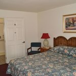 Handicap room with king-size bed and walk-in shower.