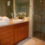 bath off twin room with large shower with stone tiles, benches