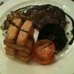 Lincolnshire Rib Eye Steak pan fried with vine plum tomato, field mushroom & chunky chips