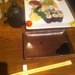 Sushi, the pot the soy sauce came in and the way the chopsticks were presented to us