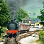 Steam train leaves Bolton Abbey Station
