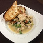 Shrimp and Bay Scallops in a Beurre Blanc sauce with Mushrooms, Shallots, Green Onions, over Gre