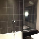 the clean and spacious bathroom with heated mirrors and seperate toilet