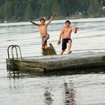 Taking a leap off of the swimming dock