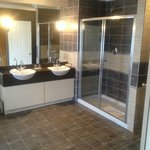 Very Large Bathroom with double sinks, large rain shower, jacuzzi bath and TV!