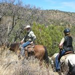 Head Wrangler Craig leads guests up the trail to the wilderness above Portal...