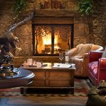 Enjoy a wood burning fire in our Grand Western Lobby