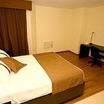 Hotel Joy Suites Photo