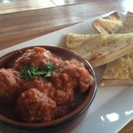 Lamb meatballs in a cumin, allspice and cinnamon infused tomato sauce with grilled bread dressed