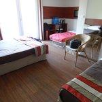 Chambre avec lit d'appoint