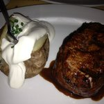 Fillet with baked potato and sour cream