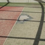 Dodgy tennis court surface