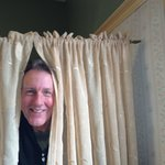 Bill hanging new drapes for you in the Hunt Room!