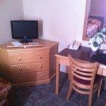 TV, dresser and dest area.