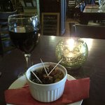 Olives to start, and a glass of merlot