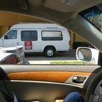 Broken window airport shuttle van