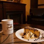 Turtle Cheesecake and coffee by the fireplace