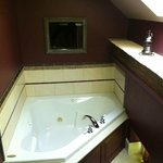 Whirlpool bath with bath robes and lantern in Royal Suite