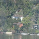 The view of the house (with blue awning) from a boat on the lake