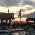Viewing the sunset from the pool at Ricks Cafe