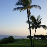 View from our room across the golf course to the ocean at sunset