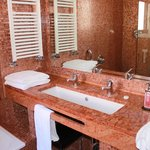 Pretty Tiled Bathroom With Large Sink