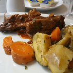Rabbit under a red wine sauce with herbs