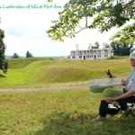 An artist paints the dramatic hills of Fort Anne National Park