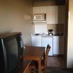 TV, dresser, table, kitchenette