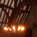 an old chandelier to match the medieval ceiling...