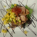 Hamachi over spring mix finished with a pineapple-mango salsa