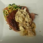 Proscuitto wrapped Filet with a julienne veggy mix, finished with a crab white wine beurre blanc