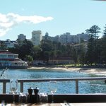view of little beach next to wharf from our table