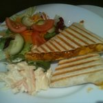 Hot chicken tikka wrap with salad and homemade coleslaw