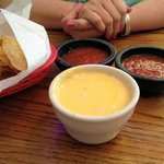Miguelito's chips are are quite good. The complimentary salsa is spicy, but the queso is bland.