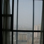 The view is spoiled by the steel net outside the windows.