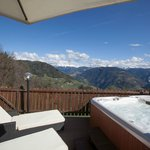 Terrace with hot tup and Dolomites Panorama