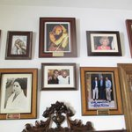 Wall of dining room with photos of past VIP guests.