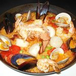 Pilot House Style Paella - Coconut Red Curry Rice, Baked with Piquillo Peppers,  Clams, Mussels
