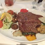 This was the best T-bone steak succulent cooked to perfection service was excellent food hot  Ri