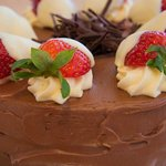 Chocolate Cake Topped with a Chocolate Ganache and White Chocolate Strawberries