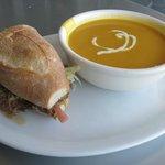 Slow-cooked pork shoulder sandwich and heirloom organics carrot soup.