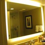 Lighted mirror in bathroom