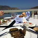 Eating stuffed vine leaves for €6 on the hotel jetty.